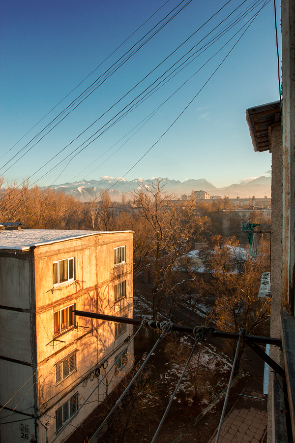 the view from my balcony, overlooking the typical neighbourhood in Bishkek with the majestic Tian Shan Mountains in the background