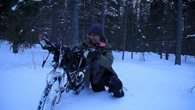 not easy to move my bike through the deep snow. i sunk as deep as my waist