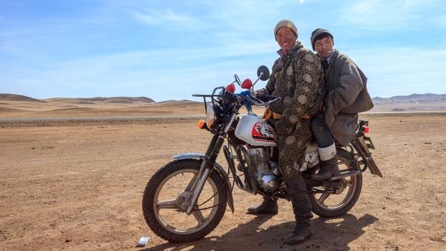 Mongolian men on a Chinese motorbike
