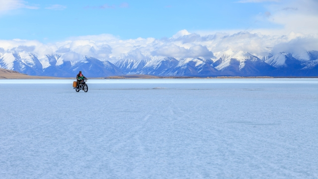 hehe, people are riding their motorbikes over the frozen lake of TsagaanNuur