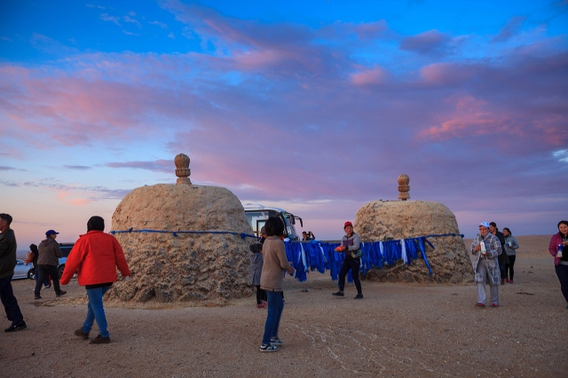 locals performing some rituals near the temple in the Gobi Desert