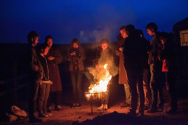 tourists surrounded the fire in the cold night