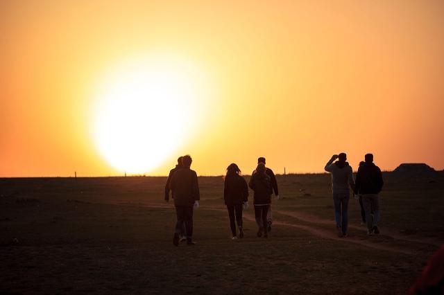 walking towards the sunset