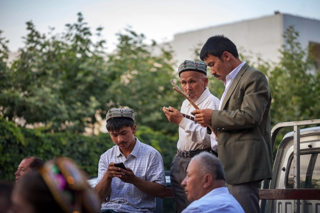 Uighur musicians playing their traditional music celebrating the wedding