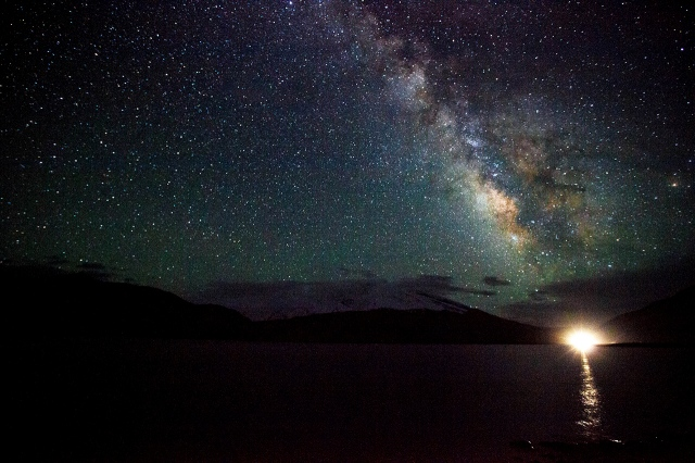 the majestic milky way standing proudly over the peak of Muztagh Ata