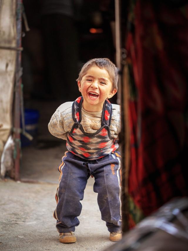 a happy Tajik boy