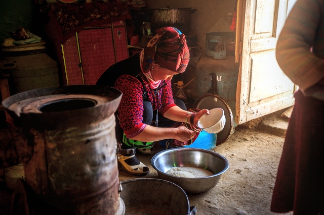 Kyrgyz woman preparing our food