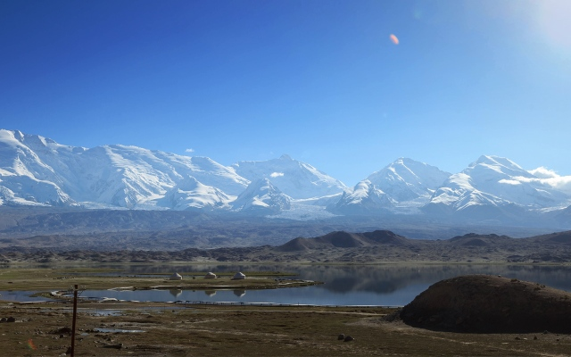 beautiful view of Karakul Lake. Those are Kyrgyz yurts near the lake