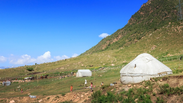 Kyrgyz yurts along the roadsides in the Sussamyr plateau