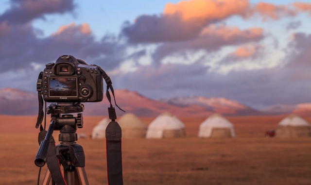 capturing sunset over Kyrgyz yurts